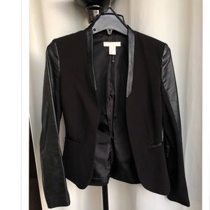 Black blazer with leather sleeves.